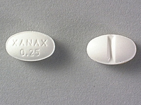 "This medicine is a white, oval, scored, tablet imprinted with ""XANAX 0.25""."
