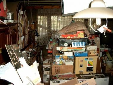 This photo shows the cluttered living space of a c