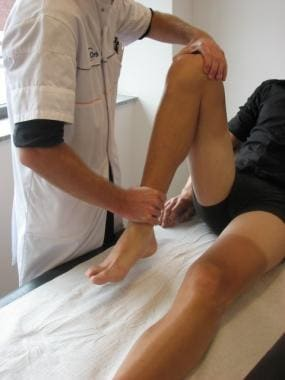 Flexing the knee in passive mobilization.