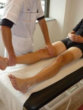 Extending the knee in passive mobilization.