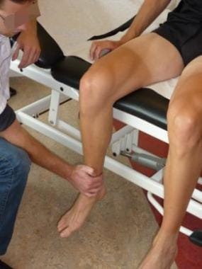 Examiner holds the knee in a steady position for i