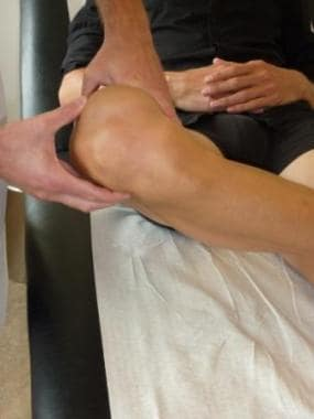 Palpating the lateral collateral ligament in later