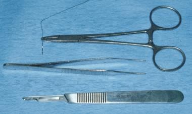 A No. 15 Bard-Parker blade, atraumatic forceps, an