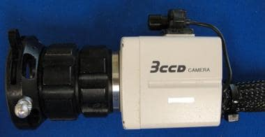 Camera attachment with mounted microphone.