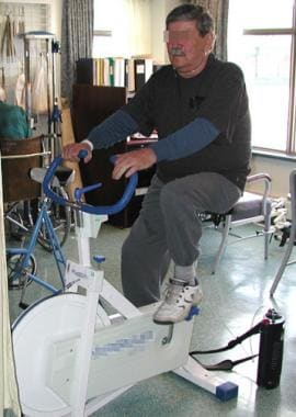 Lower extremity exercise by stationary bicycling i