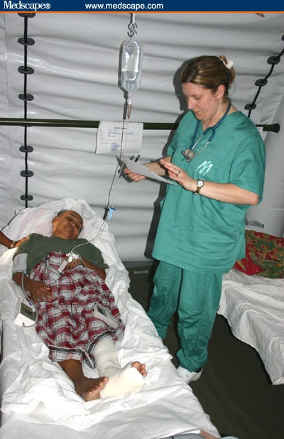 volunteer nurse jeanie schmidt with imc cares for patients in the recovery room of a field hospital in aceh indonesia photo international medical