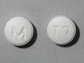"This medicine is a white, round, tablet imprinted with ""M"" and ""T7""."