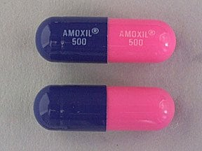 "This medicine is a pink royal blue, oblong, capsule imprinted with ""AMOXIL  500"" and ""AMOXIL  500""."