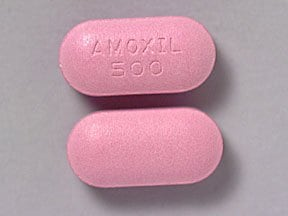 "This medicine is a pink, oblong, film-coated, tablet imprinted with ""AMOXIL  500""."