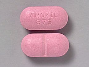 "This medicine is a pink, oblong, scored, film-coated, tablet imprinted with ""AMOXIL  875""."