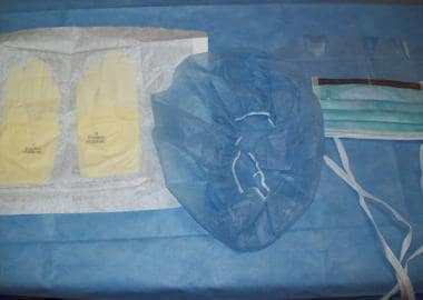 Sterile gloves, hat, and face shield.