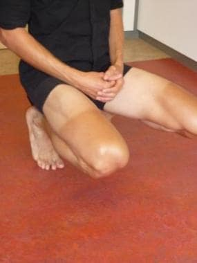 Patient in a squatting position for a hyperflexion