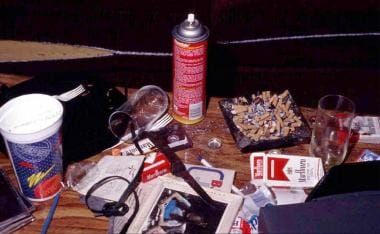 Items noted on a table near a decedent found dead
