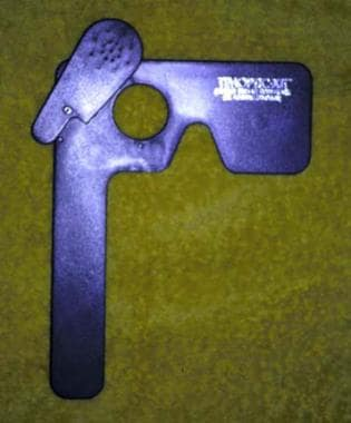 A paddle occluder with an attached pinhole facilit