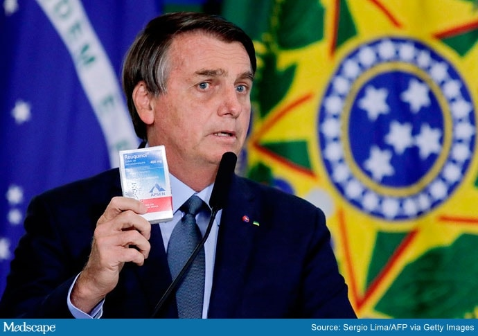 The COVID-19 Pseudoscience Suffocating Brazil     President of Brazil Jair Bolsonaro holds up a box of hydroxychloroquine during a ceremony in which Eduardo Pazuello took office as Minister of Health.  Health